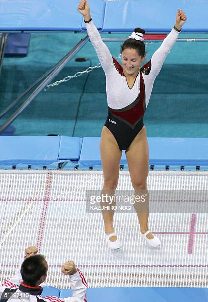 German Anna Dogonadze celebrates her victory in the women's trampoline final 20 August 2004 at the Olympic Indoor Hall during the Athens 2004...