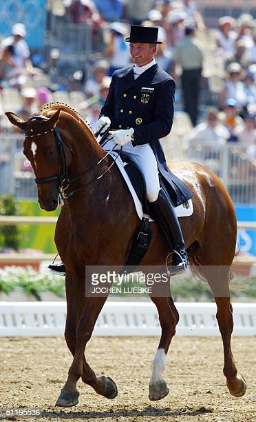 "German dressage rider Hubertus Schmidt rides his horse ""Wansuela Suerte"", 20 August 2004 at the Markopoulo Olympic Equestrian Centre in Athens during..."