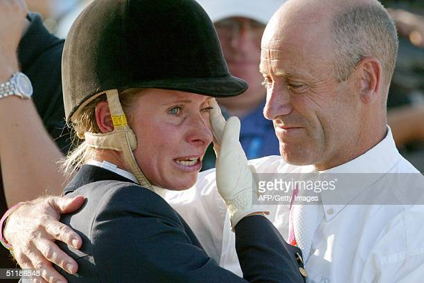 German eventing rider Bettina Hoy cries tears of joy 18 August 2004 at the Markopoulo Olympic Equestrian Centre in Athens after finishing the team...