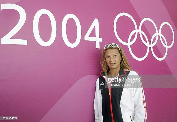 German Franziska van Almsick poses for the media prior to a press conference 12 August 2004 one day before the beginning of the 2004 Olympic Games...