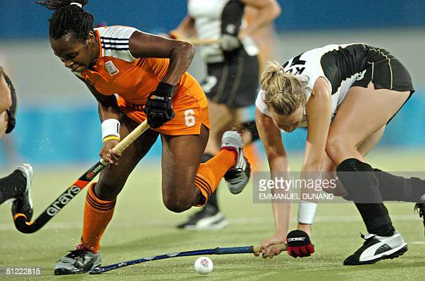 German hockey player Anke Kuehn vies for the ball against Dutch player Maartje Scheepstra in the final of the women's hockey competition at the 2004...