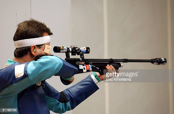 German Michael Jakosits shoots during the men's 10 meters running target qualifying 19 August 2004 in Markopoulo shooting center at the 2004 Olympic...