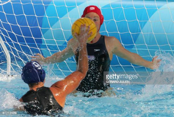 Giusy Malato from Italy tries to score in front of US goalkeeper Jacqueline Franck during their women's waterpolo semifinal match at the Olympic...