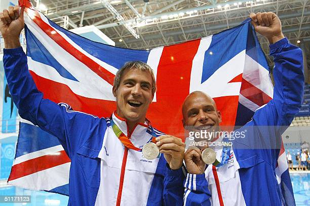 Great Britain's Leon Taylor and Peter Waterfied celebrate their 2004 Olympic silver medals in the men's 10 meters synchronised platform final in...
