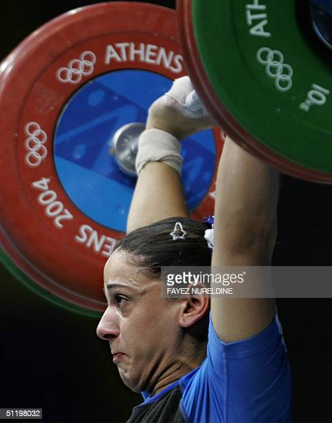 Greece's Christina Ioannidi competes during the women's 75 kg weighlifting competition of the Olympic games at Nikaia Olympic Weighlifting Hall in...