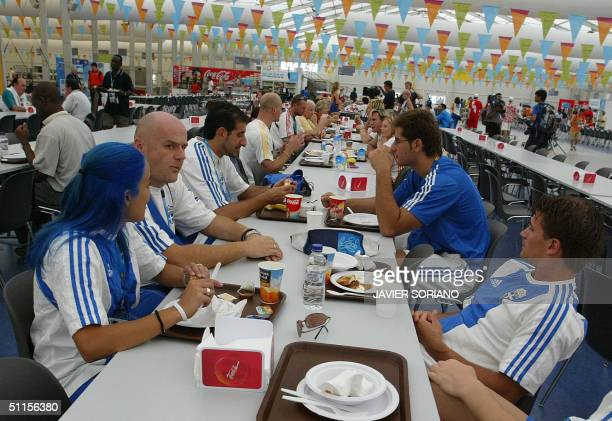 Greek athletes have lunch at the Olympic village in Athens 10 August 2004. The Olympic Games start 13 August 2004. AFP PHOTO JAVIER SORINAO