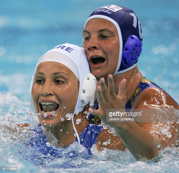 Greek Evangelia Moraitidou vies with Marina Gritsenko of Kazakhstan during their team's Olympic Games women's preliminary group B match against...