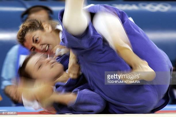 Greek judoka Varvara Akritidou fights with Anastasiia Matrosova of Ukraine during their second round match of women's judo under 78kgs category of...