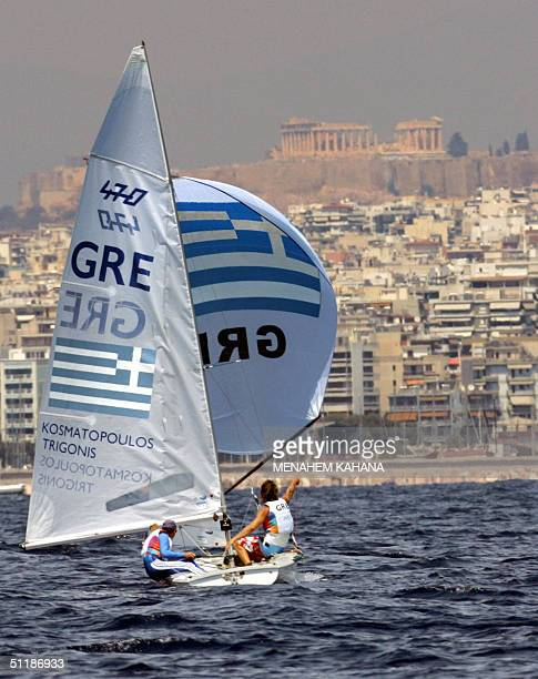 Greek sailors Andreas Kosmatopoulos and Konstantinos Trigkonis sail passes by Acropolis during the Men's DoubleHanded Dinghy470 class race seven 18...