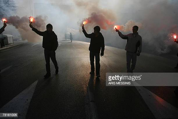 Greek students hold up lit flares during a protest in Athens against government plans to reform university education 31 January 2007 Students and...