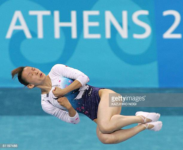 Haruka Hirota of Japan performs in the air during the women's trampoline final 20 August 2004 at the Olympic Indoor Hall during the Athens 2004...