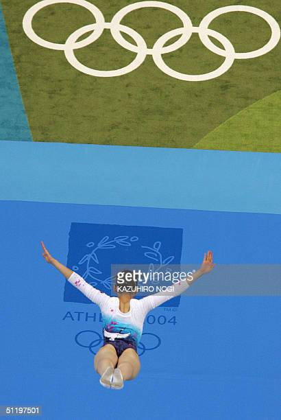 Haruka Hirota of Japan performs in the air during the women's trampoline qualification 20 August 2004 at the Olympic Indoor Hall during the Athens...