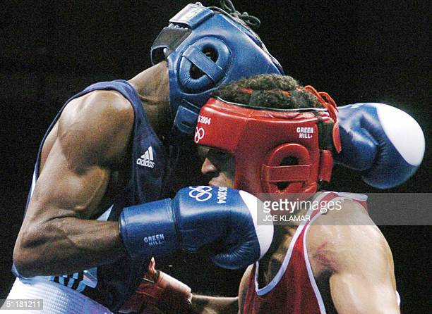 Hicham Mesbahi of Morocco fights against Botswana's Lechedzani Luza in their BOT fly 51kg preliminary round match at the Peristeri Boxing hall during...
