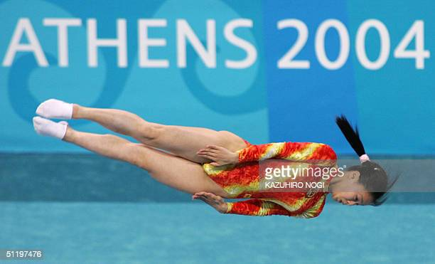 Huang Shanshan of China performs at the women's trampoline final 20 August 2004 at the Olympic Indoor Hall during the Athens 2004 Olympics Games...
