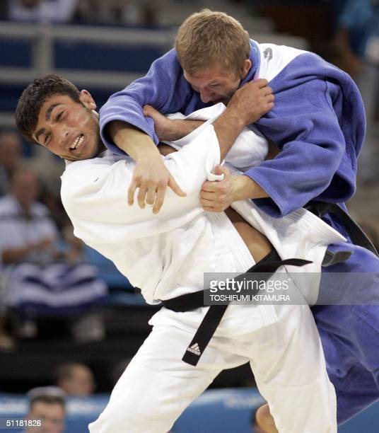Ilias Iliadis of Greece attempts to throw Roman Gontyuk of Ukraine en route to winning the final and gold medal in the men's judo -81kgs category in...