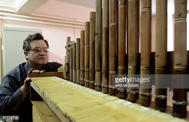 Instrumentmaker George Paraschos works on a reconstructed version of the hydraulis an ancestor of the modern church organ invented in the 3rd century...