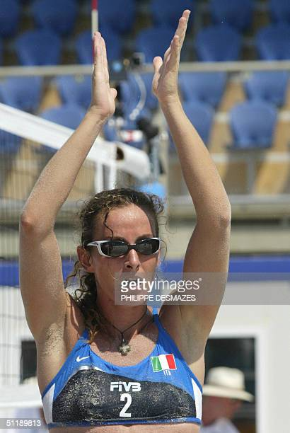 Italy's Daniela Gatteli celebrates after her third round preliminary women's beach volleyball match at the 2004 Olympic Games in Athens, 19 August...