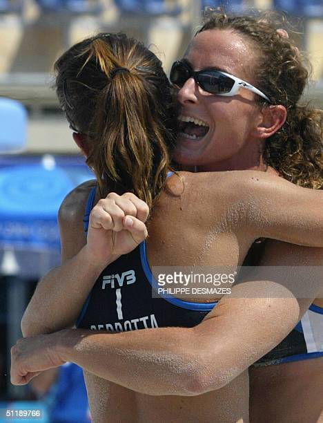 Italy's Lucilla Perrotta and Daniela Gatteli celebrate during their third round preliminary women's beach volleyball match at the 2004 Olympic Games...