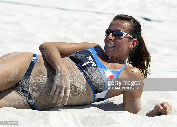 Italy's Lucilla Perrotta smiles during her third round preliminary women's beach volleyball match at the 2004 Olympic Games in Athens, 19 August...