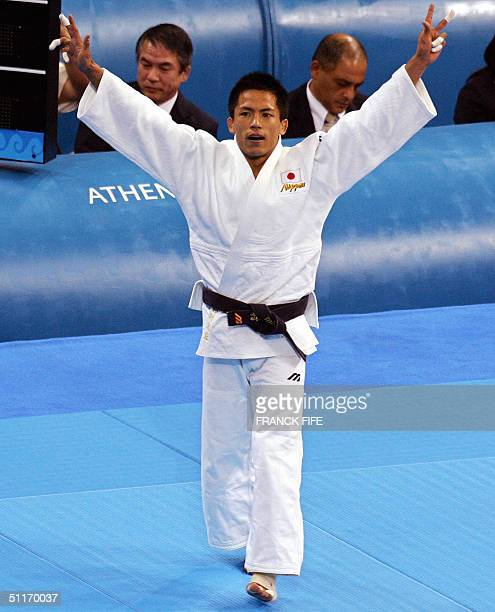 Japan's Tadahiro Nomura celebrates after the final of the men under 60 kg preliminaries 14 August 2004 at the Ana Liosia Olympic Hall in Athens...