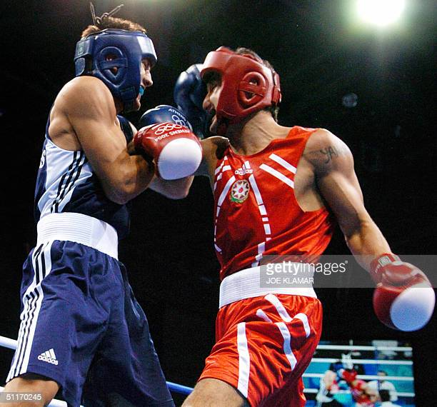 Javid Taghijev of Azerbaijan and Georgios Gazis of Greece exchange blows during their Olympic Games preliminary 75 kg Middleweight bout at Peristeri...