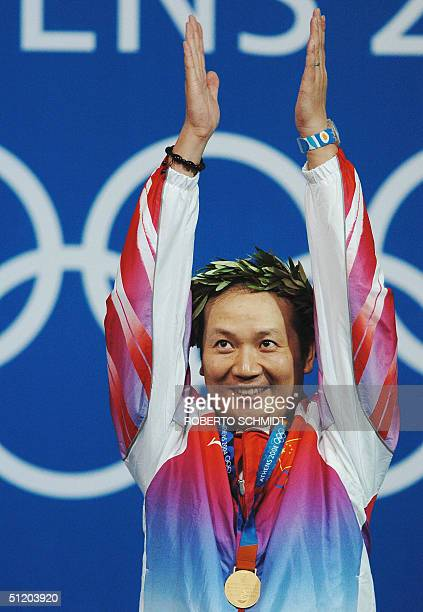 Jia Zhanbo of China celebrates after receiving the gold medal for the Men's 50m Rifle 3 Positions competition in the Athens 2004 Olympic Games at the...