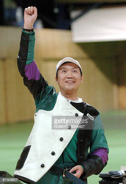 Jia Zhanbo of China reacts to winning the Men's 50m Rifle 3 Positions competition in the Athens 2004 Olympics at the Markopoulo Shooting Center in...