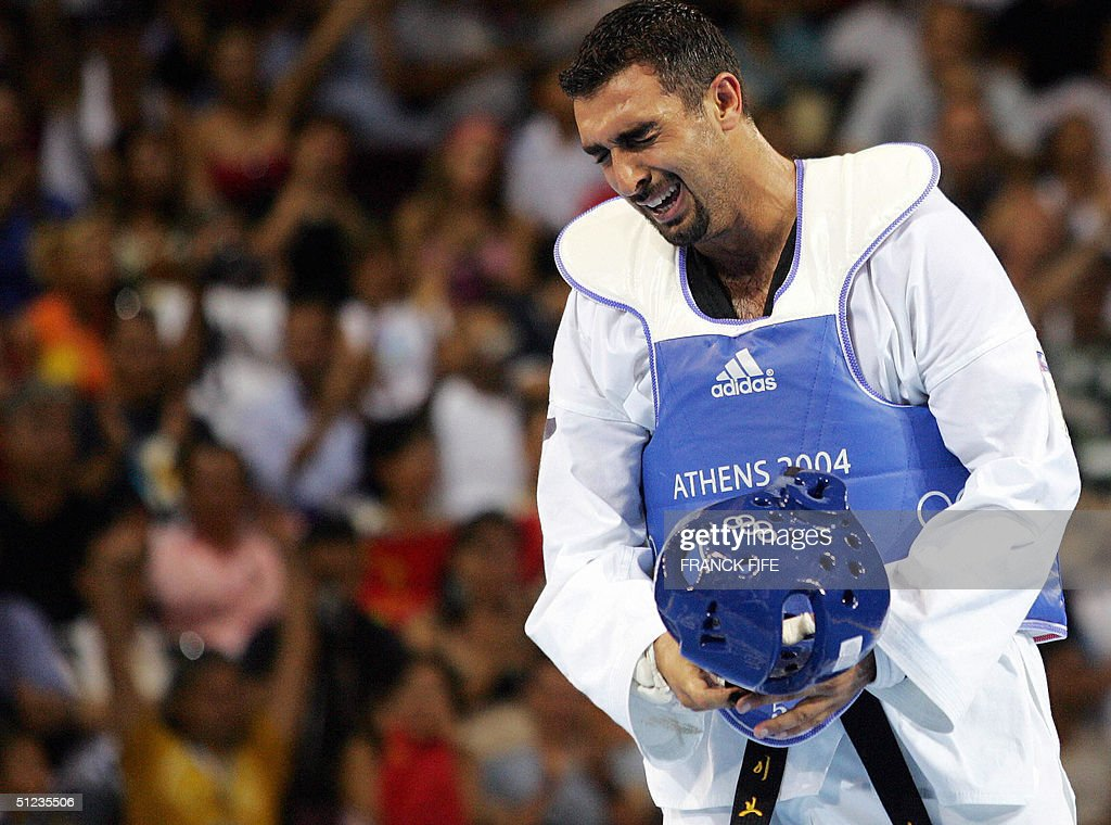 Jordan's Ibrahim Kamal reacts to defeat against Pascal Gentil of France in the men's +80 kg taekwondo match of the 2004 Olympic Games 29 August 2004 in Athens. Gentil won 6-2 to take home the bronze medal. AFP PHOTO / Franck FIFE