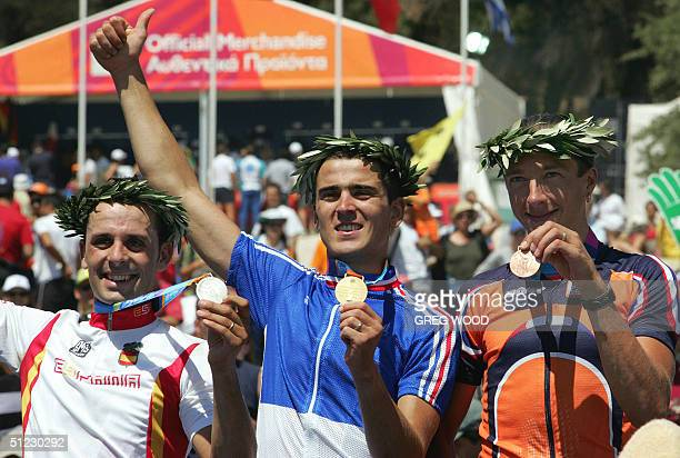 Julien Absalon of France Jose Antonio Hermida of Spain and Bart Brentjens of the Netherlands show off their medals won for the Athens Olympic Games...
