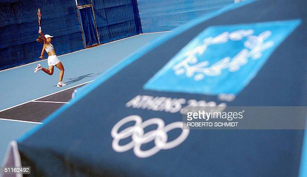 Justine HeninHardine of Belgium hits a back hand during an afternoon practice at the tennis Olympic venue in Athens 12 August 2004 one day before the...
