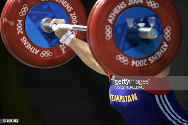 Kazakhstan's Tatyana Khromova competes during the women's 75 kg weighlifting competition of the Olympic games at Nikaia Olympic Weighlifting Hall in...