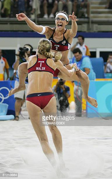 Kerri Walsh and Misty May jubilate after winning the women's beach volleyball gold medal match against Australia at the 2004 Olympic Games, in Athens...