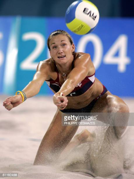 Kerri Walsh of the USA returns the ball en route to a third round beach volleyball victory over the Czech Republic at the 2004 Olympic Games in...