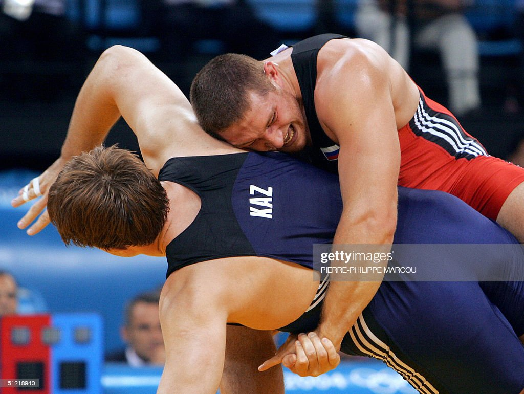 Khasan Baroev of Russia (TOP) battles Georgiy Tsurtsumia of Kazakhstan (BOTTOM) in the men's Greco-Roman 120 kg gold medal match of the 2004 Olympic Games 25 August 2004 in Athens. Baroev, the reigning world champion, underlined his superiority in the 120kg class by defeating Kazakhstan's Georgiy Tsurtsumia in a gripping final to take the gold medal.