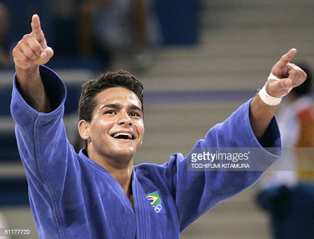 Leandro Guilheiro of Brazil expresses his joy after beating Victor Bivol of Moldova in the bronze medal final of men's judo under 73kgs category of...