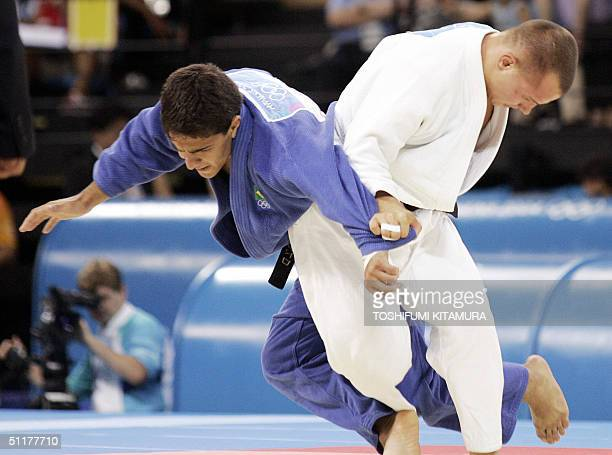 Leandro Guilheiro of Brazil fights with Victor Bivol of Moldova during bronze medal final of men's judo under 73kgs category of the Athens summer...