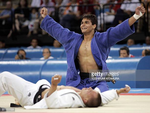 Leandro Guilheiro of Brazil raises his arms in jubilation after beating Victor Bivol of Moldova in the bronze medal final of men's judo under 73kgs...