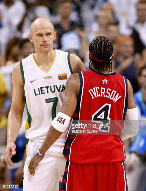 Lithuania's team captain Saulius Stombergas looks towards USA's Allen Iverson during their Olympic Games men's basketball bronze medal match 28...