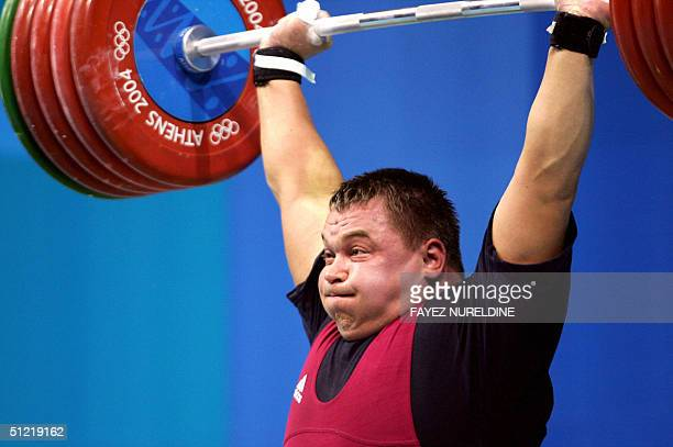 Lithuania's Viktors Scerbatihs lifts in the men's 105 kg weighlifting competition of the Olympic Games at Nikaia Olympic Weighlifting Hall in Athens...