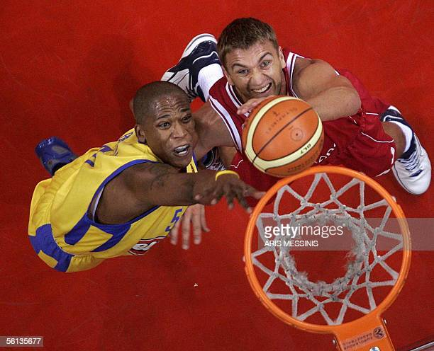 Maceo Baston of Maccabi Tel Aviv jumps for a rebound with Olympiakos'Andrija Zizic during their group B Euroleague basketball game at Peace and...