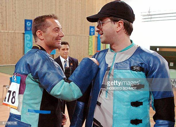Manfred Kurzer of Germany is congratulated by German shooter Michael Jakosits also of Germany after Kurzer won the 10m running Targe shooting at the...