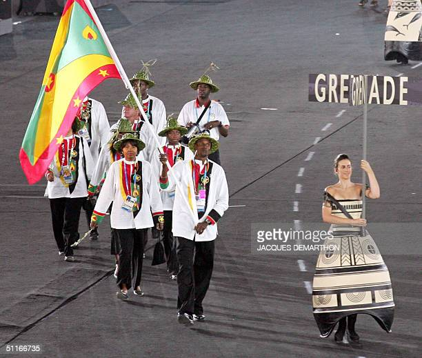 Members of the Grenadian delegation parade 13 August 2004 during the opening ceremony of the 2004 Olympic Games at the Olympic Stadium in Athens The...