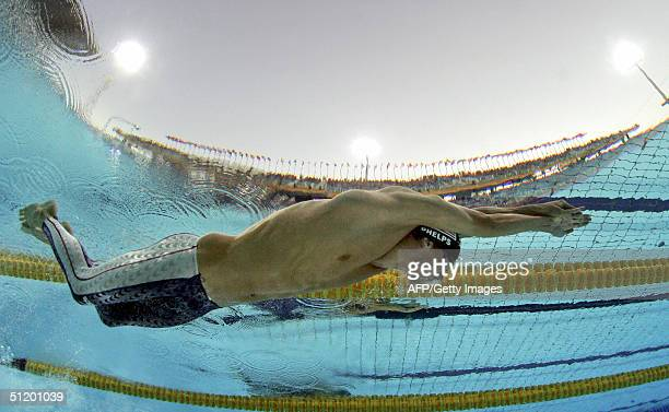 Michael Phelps of the US swims to a gold medal in the 100meter butterfly at the Olympic Aquatic Centre during the 2004 Olympic Games in Athens 20...