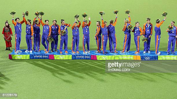 Netherlands' men's hockey team celebrate their silver medals on the podium after the men's field hockey gold medal final at the 2004 Olympic Games in...