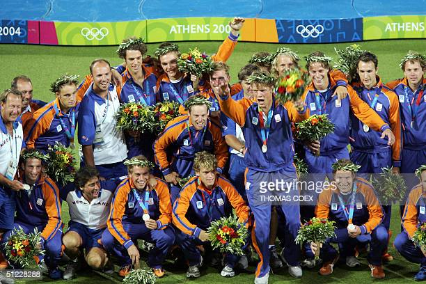 Netherlands' men's hockey team celebrate their silver medals on the podium after the men's field hockey gold medal final of the 2004 Olympic Games in...