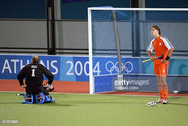 Netherlands' players Guus Vogels and GeertJan Derikx are dejected after Australia won the men's Field Hockey gold medal final between Australia and...