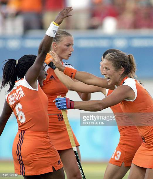 Netherland's Sylvia Karres celebrates with her teammate Maartje Scheepstra after she scored the first goal for her team during the semifinal match of...