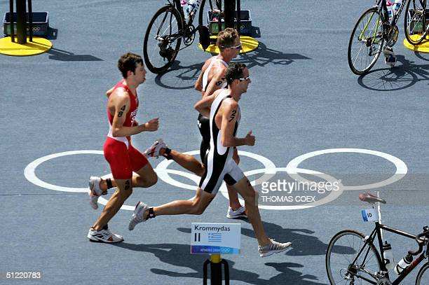 New Zealand's Hamish Carter his compatriot Bevan Docherty and Switzerland's Sven Riederer run during the men's triathlon at the 2004 Olympic Games in...