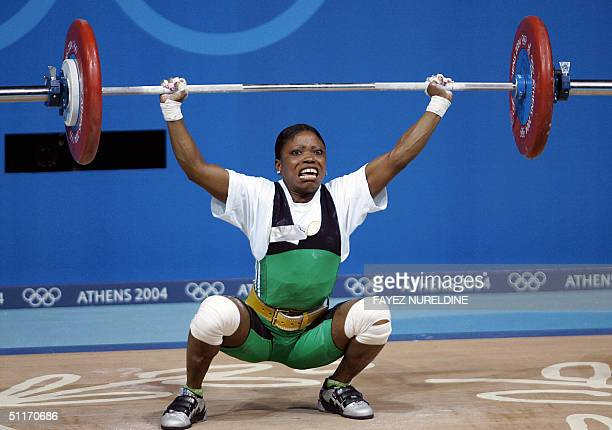 Nigerian Blessed Udoh performs a lift in the women's weighlifting 48kg category 14 August 2004 at the 2004 Olympic Games in Athens AFP PHOTO Fayez...