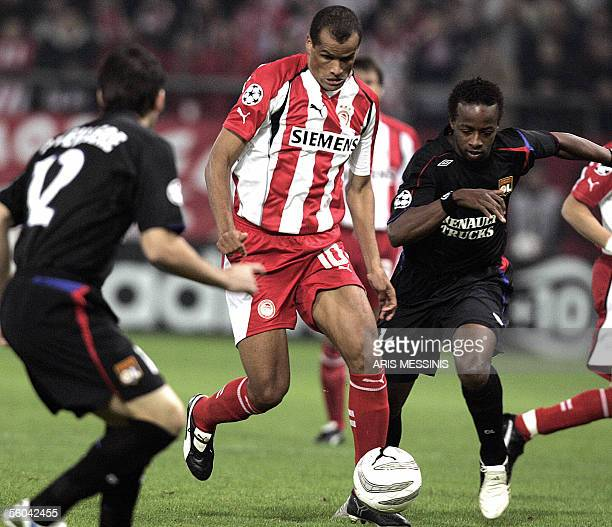 Olympiakos' Rivaldo of Brazil fights for the ball with Lyon's Sidney Govou during their Group F Champions League football game at the Karaiskaki...